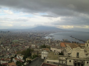 Naples and Vesuvius (with its head in the clouds).