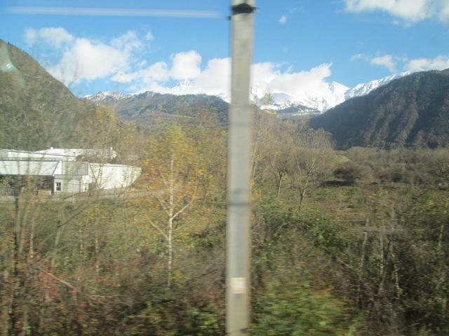 The French Alps from the Milan-Paris TGV:  those posts have an affinity for my camera!