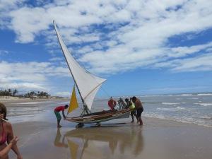 Hauling the jangada back up the beach.